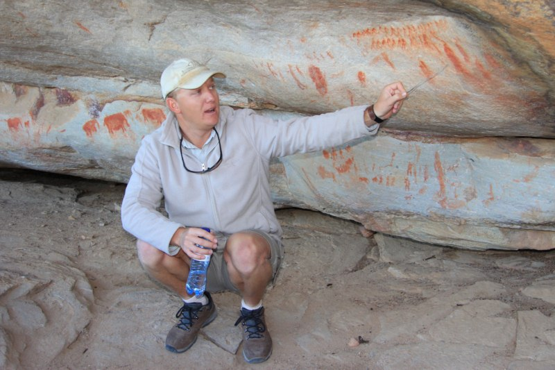 Seppie our knowledgeable guide explaining rock art