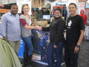 Jaclyn and Hadley with staff at Hi-Tec Access Park taking delivery of new hiking boots
