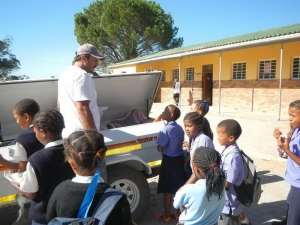 Children setting off on a CLT camp, packing their bags into the trusty trailer with much excitement
