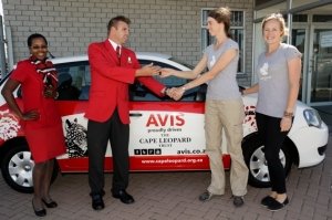 Elizabeth Martins and Jaclyn Stephenson get the key to the door from Daniel Kerslake of Avis Cape Town.